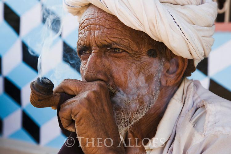 Old man smoking pipe, Dasada, Gujarat, India --- Model Released