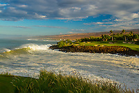 As the sun rises, a wave breaks near Hole No. 3 of Mauna Kea Golf Course and through Kauna'oa Bay, Big Island.