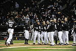 CHICAGO - APRIL 12:  Teammates gather at home plate to greet Alexei Ramirez #10 of the Chicago White Sox after Ramirez hit a walk-off game winning home run off of Bobby Cramer #26 of the Oakland Athletics in the 10th inning on April 12 00, 2011 at U.S. Cellular Field in Chicago, Illinois.  The White Sox defeated the Athletics 6-5.  (Photo by Ron Vesely)  Subject: Alexei Ramirez;Bobby Cramer.