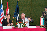 Csaba Hende (R) Defence Minister for Hungary puts a pen into his pocket after signing an aggreement with Eleni Tsakopoulos Kounalakis (L) ambassador for the United States of America during the presentation of the coalition support for Hungary by the US military in Szolnok, Hungary on July 18, 2011. ATTILA VOLGYI
