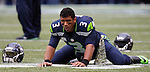 Seattle Seahawks quarterback Russell Wilson (3) stretches out before their game against the New York Giants at CenturyLink Field in Seattle, Washington on November 9, 2014. The Seahawks  beat the Giants 38-17.  ©2014. Jim Bryant Photo. All rights Reserved.
