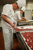 "Red Currants prepared by Executive Pastry Chef Steve Evetts, left. Pastry chefs at the Marriott Marquis Hotel in Times Square prepare 10,000 desserts for over 3000 guests on Saturday, December 31, 2011. The hotel, with a prime location over-looking Times Square and the ball drop, is hosting a ""Masquerade Gala"" with hundreds of themed desserts for their guests. (© Richard B. Levine)"
