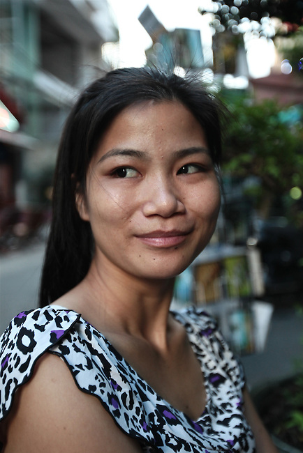 Linh, 24, a cigarette seller, poses for a portrait in the Pham Ngu Lao ward of Ho Chi Minh City, Vietnam. Sept. 10, 2011.