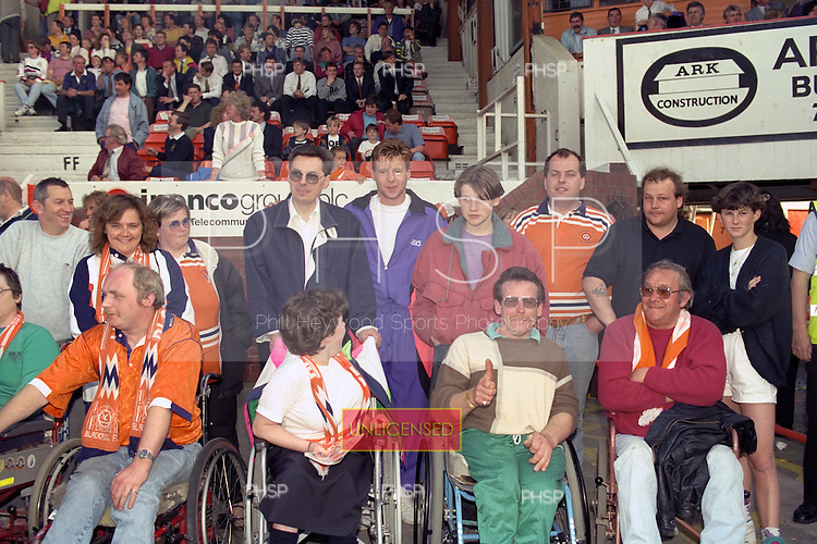 Dylan Kerr poses wit the disabled supporters prior to Pool's Play off semi final second leg against Barnet