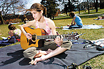 Sentinel/Dan Irving.Hope College sophomore Joanna Olson plays her guitar while relaxing outside on campus with several of her classmates on a sunny and warm Tuesday afternoon..(4/5/05)