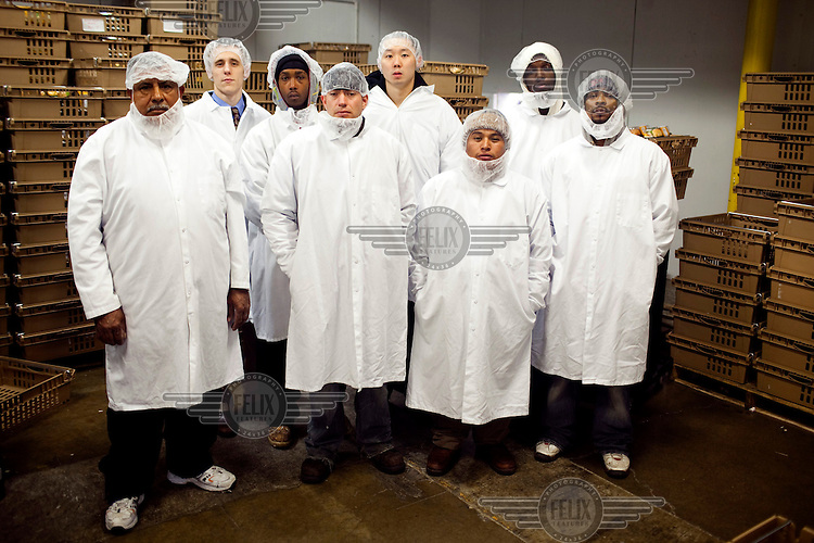 A working team, dressed in protective, at Greencore's Cincinnati facility. Greencore Group is an Irish-based company that produces convenience foods and sandwiches throughout Britain and Europe. In 2008 Greencore acquired Home Made Brand Foods in Newburyport, Massachusetts to establish Greencore North America.