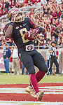 Florida State wide receiver Kermit Whitfield salutes after scoring on a 26 yard Sean Maguire pass in the first half of an NCAA college football game against Chattanooga in Tallahassee, Fla., Saturday, Nov. 21, 2015.  (AP Photo/Mark Wallheiser)