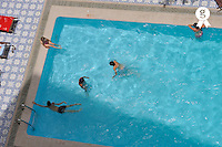 Family enjoying swimming in pool (Licence this image exclusively with Getty: http://www.gettyimages.com/detail/83154228 )