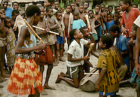 Village life in Africa: Girls dancing to the beat of boy's mokoto drum, Bodjaba tribe, Ngiri River area, Democratic Republic of the Congo (ex-Zaire)..