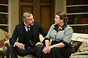 Bath, UK. 17.06.2013. RELATIVE VALUES, by Noel Coward, opens the 2013 summer season at the Theatre Royal Bath. Picture shows: Rory Bremner (Crestwell, the butler) and Caroline Quentin (Moxie, the housemaid). Photograph © Jane Hobson.