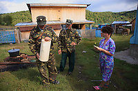 """To organize the harvest, we need several horses and the neighbors in Sabit Galin are asked to contribute. A forest warden inspects a wooden jar of honey named """"Batman""""."""
