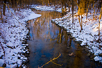 Late afternoon sun warms the eastern bank of a stream running through Inniswood Metro Park after a snow storm.  Photo Copyright Gary Gardiner. Not be used without written permission detailing exact usage.