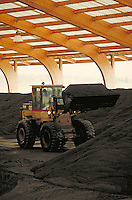 front end loader moving material at industrial catalyst recycling facility