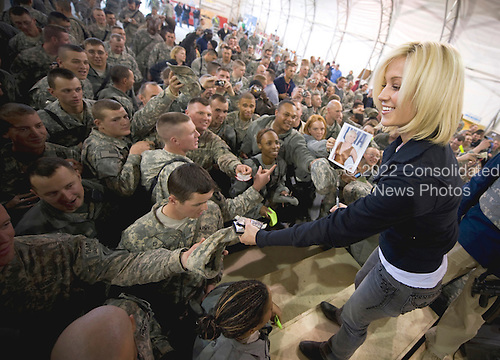 Forward Operating Base Sharana, Afghanistan - December 17, 2008 --  American Idol contestant and country musician Kellie Pickler signs autographs for soldiers after performing at the 2008 USO Holiday Tour at Forward Operating Base Sharana, Afghanistan on Wednesday, December 17, 2008.  Tour host United States Navy Admiral Mike Mullen, chairman of the Joint Chiefs of Staff, along with his wife Deborah, welcomed comedians John Bowman, Kathleen Madigan and Lewis Black; actress Tichina Arnold;  and Grammy award winning musician Kid Rock on the tour bringing music and entertainment to service members and their families stationed overseas. .Credit: Chad J. McNeeley - DoD via CNP