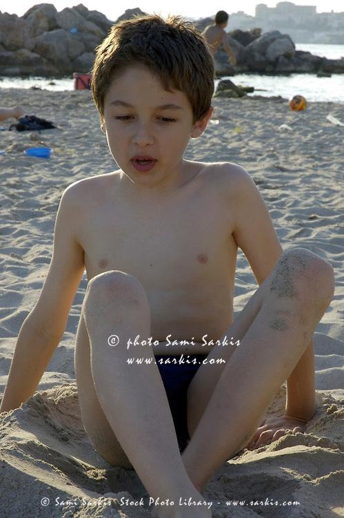 Filename: RF-Beach-Boy-Sandy-Shirtless-Sitting-Seaside-PPL720.jpg