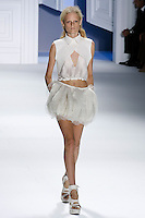 Hanne Gaby Odiele walks runway in a White textured silk v-neck drawstring top with super pique criss cross collar cutaway overlay, and White organza and tulle drawstring bubble skirt, by Vera Wang, for the Vera Wang Spring 2012 collection, during Mercedes-Benz Fashion Week Spring 2012.
