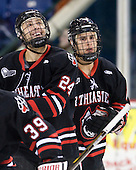 Drew Daniels (Northeastern - 24) and Drew Ellement (Northeastern - 2) celebrate McLaughlin's tying goal. - The visiting Northeastern University Huskies defeated the University of Massachusetts-Lowell River Hawks 3-2 with 14 seconds remaining in overtime on Friday, February 11, 2011, at Tsongas Arena in Lowelll, Massachusetts.
