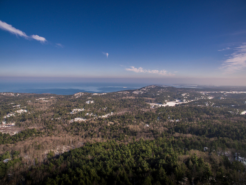 Aerial view of Lake Superior shoreline and topography from Hogback Mountain looking towards Sugarloaf Mountain and the city of Marquette, Michigan.