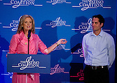 Ann Romney, left, thanks her youngest son, Craig, right, for his introduction at the Latino Coalition Luncheon during the 2012 Republican National Convention in Tampa Bay, Florida on Tuesday, August 28, 2012.  .Credit: Ron Sachs / CNP.(RESTRICTION: NO New York or New Jersey Newspapers or newspapers within a 75 mile radius of New York City)
