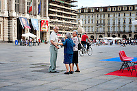 Old people on the Piazza Castello in Turin (Italy, 18/06/2010)