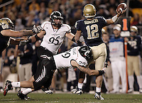 PITTSBURGH, PA - NOVEMBER 05: Tino Sunseri #12 of the Pittsburgh Panthers throws the ball while being hit by Dan Giordano #99 of the Cincinnati Bearcats on November 5, 2011 at Heinz Field in Pittsburgh, Pennsylvania.  (Photo by Jared Wickerham/Getty Images)
