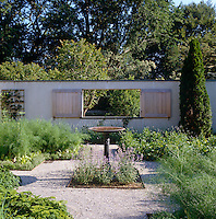 Shutters cover the exterior windows of the walled garden for greater seclusion