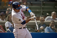 New York Mets shortstop Ruben Tejada connects a hit during their game against Miami Marlins at Citi Field Stadium in New York. Photo by Eduardo Munoz Alvarez / VIEW.