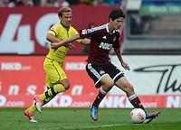 FUSSBALL   1. BUNDESLIGA  SAISON 2012/2013   2. Spieltag 1. FC Nuernberg - Borussia Dortmund       01.09.2012 Mario Goetze (li, Borussia Dortmund) gegen Timm Klose (1 FC Nuernberg)