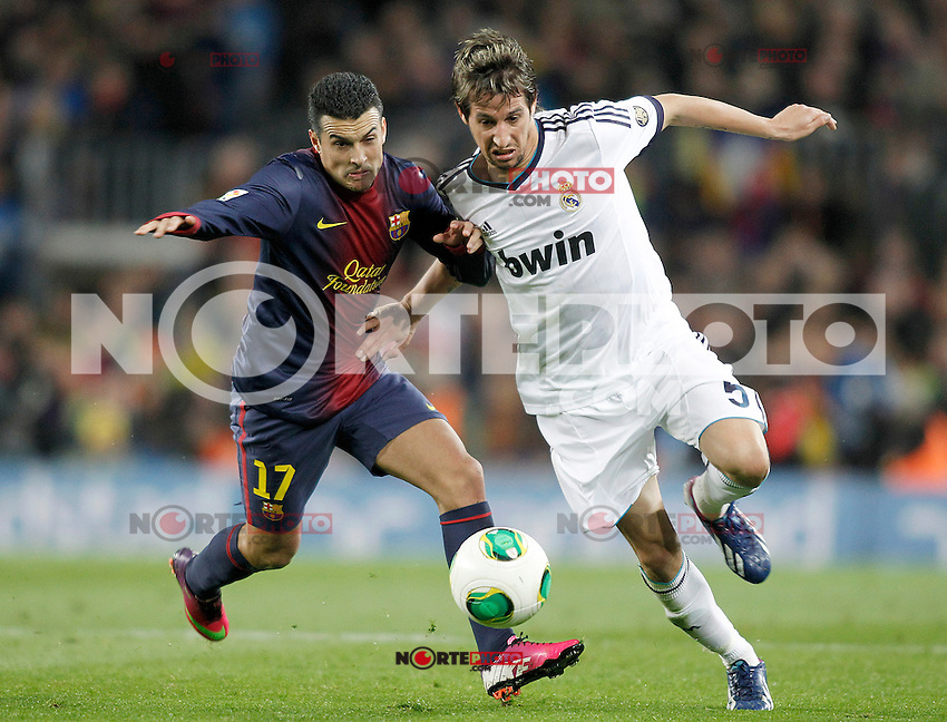 FC Barcelona's Pedro Rodriguez (l) and Real Madrid's Fabio Coentrao during Copa del Rey - King's Cup semifinal second match.February 26,2013. (ALTERPHOTOS/Acero) /Nortephoto