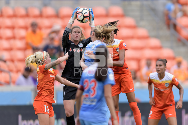 Houston, TX - Saturday April 15, 2017: Alyssa Naeher grabs the ball in front of the goal during a regular season National Women's Soccer League (NWSL) match won by the Houston Dash 2-0 over the Chicago Red Stars at BBVA Compass Stadium.
