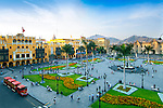 The Plaza Armas (also known as Plaza Mayor) is the main square in downtown Lima, Peru.  The Presidential Palace and Spanish colonial style yellow painted buildings surround the well manicured plaza.