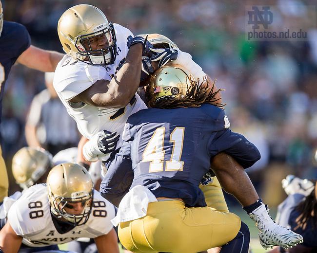 Oct. 10, 2015; Navy Midshipmen fullback Chris Swain (37) is tackled by Notre Dame Fighting Irish cornerback Matthias Farley (41) in the second quarter at Notre Dame Stadium. Notre Dame won 41-24. (Photo by Matt Cashore)