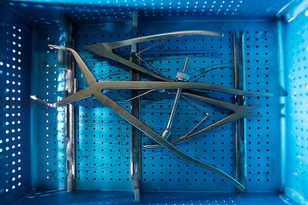 Various surgical hand tools in crate. Royalty Free