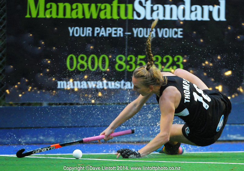 Liz Thompson slips over during the international women's hockey match between the NZ Black Sticks and USA at Endeavour Twin Turfs, Palmerston North, New Zealand on Thursday, 23 October 2014. Photo: Dave Lintott / lintottphoto.co.nz