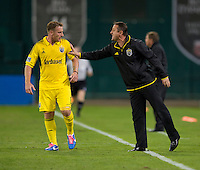 Chris Birchall (8) of the Columbus Crew talks to his head coach, Robert Warzycha, during the game at RFK Stadium in Washington, DC.  D.C. United defeated the Columbus Crew, 3-2.
