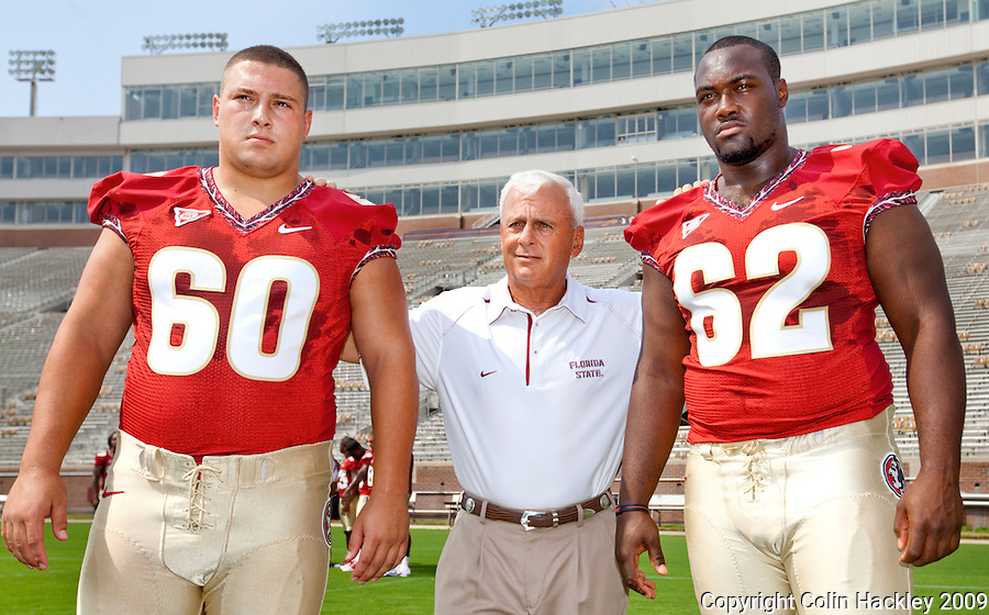 TALLAHASSEE, FL 8/8/10-FSU-080810 CH-Florida State Offensive Line Coach Rick Trickett, center, poses with  Ryan McMahon, left, and Rodney Hudson during media day Sunday in Tallahassee. .COLIN HACKLEY PHOTO