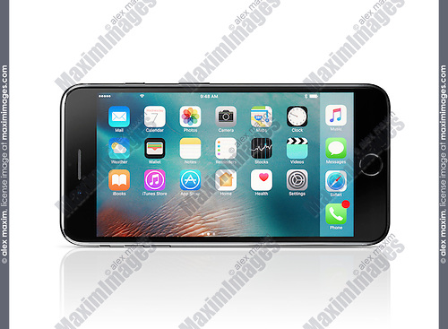 Apple iPhone 7 Plus black with desktop icons on its display lying horizontally on its side isolated on white background with clipping path