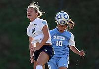 SAN DIEGO, CA - DECEMBER 02, 2012:  Ranee Premji (10) of the University of North Carolina heads away from Christine Nairn (10) of Penn State University during the NCAA 2012 women's college championship match, at Torero Stadium, in San Diego, CA, on Sunday, December 02 2012. Carolina won 4-1.