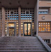 Main entrance with relief carvings on the pillars by Pierre Meauze, 1913-1978, of the Residence Lucien Paye, designed by Jean Vernon, Bruno Philippe and Albert Laprade, 1883-1978, and inaugurated 1949, in the Cite Internationale Universitaire de Paris, in the 14th arrondissement of Paris, France. Originally the Overseas French Territories House, the building was later used to house students from Sub-Saharan African countries. The CIUP or Cite U was founded in 1925 after the First World War by Andre Honnorat and Emile Deutsch de la Meurthe to create a place of cooperation and peace amongst students and researchers from around the world. It consists of 5,800 rooms in 40 residences, accepting another 12,000 student residents each year. Picture by Manuel Cohen. L'autorisation de reproduire cette œuvre doit etre demandee aupres de l'ADAGP/Permission to reproduce this work of art must be obtained from DACS.