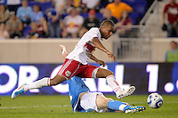Juan Agudelo (17) of the New York Red Bulls attempts to clear the tackle of Kyle Hoffer (4) of FC New York. The New York Red Bulls defeated FC New York 2-1 during a third round match of the 2011 Lamar Hunt US Open Cup at Red Bull Arena in Harrison, NJ, on June 28, 2011.