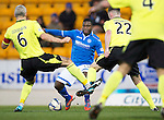 St Johnstone v St Mirren.....11.01.14   SPFL<br /> Nigel Hasselbaink is blocked by Jim Goodwin and Jason Naismith<br /> Picture by Graeme Hart.<br /> Copyright Perthshire Picture Agency<br /> Tel: 01738 623350  Mobile: 07990 594431