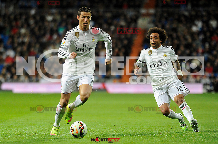 Real Madrid´s Cristiano Ronaldo and Marcelo Vieira during 2014-15 La Liga match between Real Madrid and Levante UD at Santiago Bernabeu stadium in Madrid, Spain. March 15, 2015. (ALTERPHOTOS/Luis Fernandez) /NORTEphoto.com