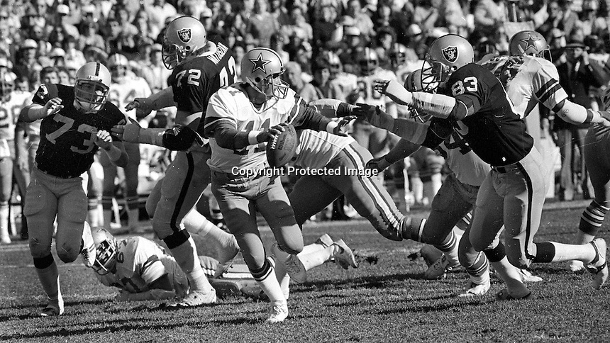Oakland Raiders put the rush on Dallas Cowboys Danny White..Dave Browning, John Matuszak, Ted Hendricks.(1980 photo by Ron Riesterer)