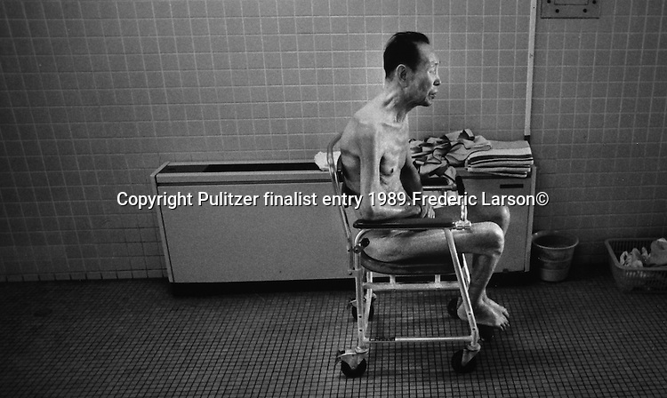 The oldest survivors, most in their 90's live on the special floors of the nursing home and must be fed and bathed by nurses' aids..Pulitzer finalist entry 1989 Frederic Larson©