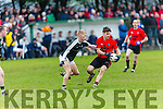 In Action Glenbeigh-Glencar' s Gavan O'Grady and Griffins Jim Liston in the  AIB Munster Junior Club Football Championship Semi-Final – Glenbeigh-Glencar (Kerry) v Gerald Griffins (Limerick) at Gerald Griffins GAA Club, Ballyhahill on Saturday