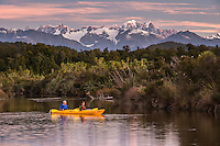 Couple kayaking in Okarito Lagoon at sunset, Westland National Park, West Coast, UNESCO World Heritage Area, South Westland, New Zealand