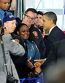 United States President Barack Obama greets firefighters following his making remarks on the economy at Fire Station #5 in Arlington, Virginia on Friday, February 3, 2012.  .Credit: Ron Sachs / Pool via CNP
