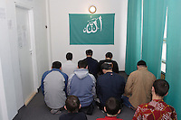Chechen mans and childrens at the midday Ramadan pray, in the arrange Mosque at the URiC Radom refugee centre. .-For security reason, the face of the adult asylum seeker have been evicted of the photography..-For security reason, the names of the adult asylum seeker have been change. .-Article 9 of the Act of 13 June 2003 on grating protection on the Polish territory (Journal of Laws, No 128, it. 1176) personal data of refugees are an object of particular protection..-Cases where publication of a picture or name of asylum seeker had dramatic consequences for this persons and is family back in Chechnya. .Please have safety of those people in mind. Thank you.
