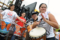 """Phoenix, Arizona (July 28, 2012) - About three hundred people marched to protest the second anniversary of the approval of some provisions of the SB 1070 immigration law. The march, called """"No Papers, No Fear"""" was organized by immigrant rights groups who say the law discriminates people of brown skin. In this photograph, Abu Ghabi plays a drum during the rally prior to the march. The women behind Ghabi also play """"drums"""" made of plastic buckets. Photo by Eduardo Barraza © 2012"""