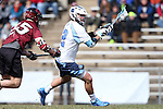 14 February 2015: North Carolina's Chad Tutton (12) and UMass's Kurt Hunziker (25). The University of North Carolina Tar Heels hosted the University of Massachusetts Minutemen in a 2015 NCAA Division I Men's Lacrosse match. UNC won the game 20-8.